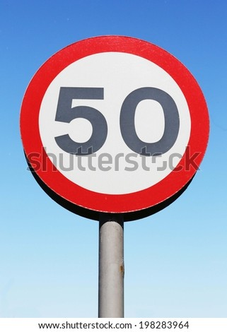 Fifty miles per hour speed limit sign against a blue sky background.  - stock photo