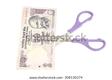 Fifty Rupee banknotes with scissors (Indian currency) isolated - stock photo