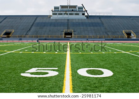 Fifty Yard Line with Bleachers - stock photo