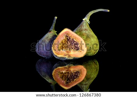Fig fruit with reflection in black background