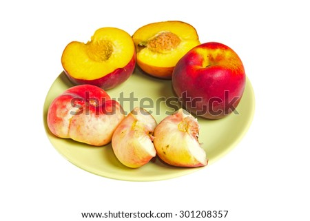 Fig peach and conventional peach on the plate.