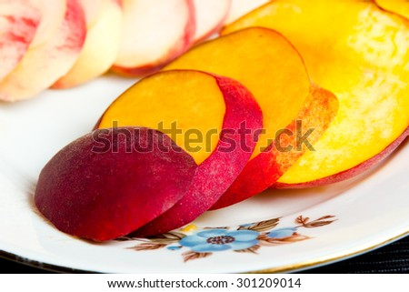 Fig peach and conventional peach on the plate. - stock photo