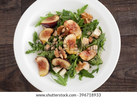 Fig with rucola, a summer mediterranean dish in a white plate.