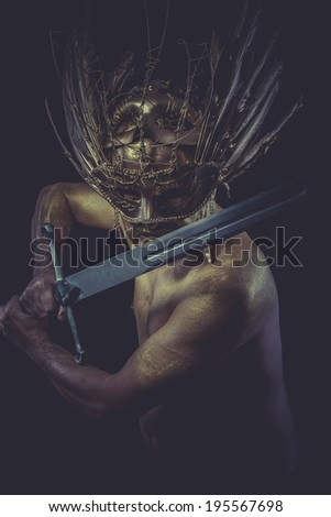 Fight, golden deity, man with wings and gold helmet - stock photo