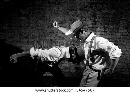 fight of the gungsters - stock photo