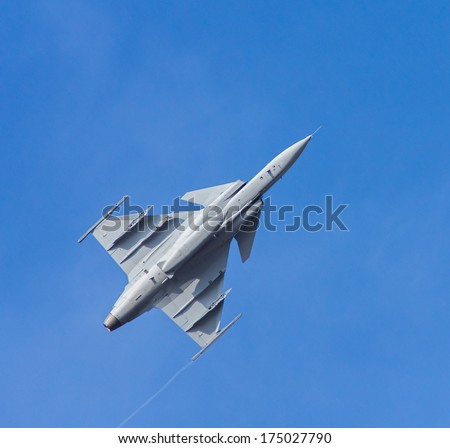 Fighter aircraft on the blue sky - stock photo