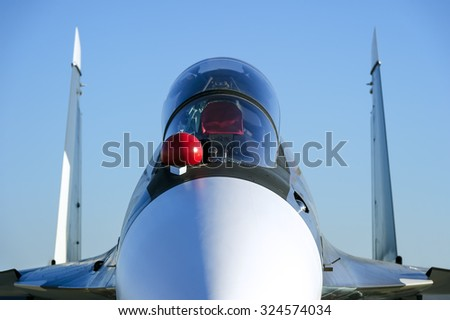Fighter-bomber jet with empty bulletproof cockpit of military multifunction plane, fourth-generation aircraft, modern army industry, supersonic air force, blue sky on background, selective focus - stock photo