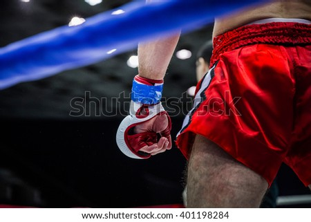 fighter boxer in corner of ring before  fight - stock photo