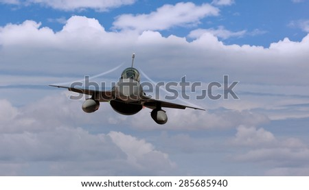 Fighter jet airborne with contrails   - stock photo