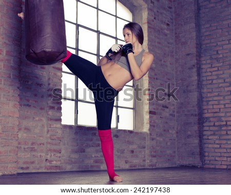 fighter making training at the heavy bag. - stock photo
