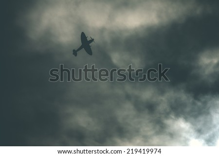 Fighter plane on cloudy sky - stock photo