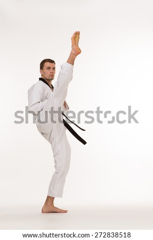Fighter show foot kick on white background