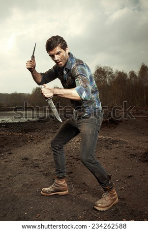 Fighter with two knives - stock photo