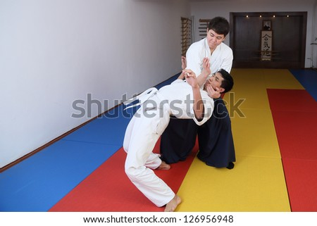 Fighting art  Aikido . In sports to  hall dojo. - stock photo