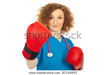 Fighting doctor woman with boxing gloves isolated on white background - stock photo