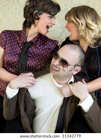 Fighting for a man - stock photo