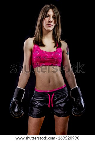 Fighting, strong woman athlete with boxing gloves - stock photo