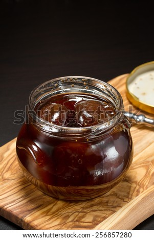 Figs and sugar syrup in a glass jar