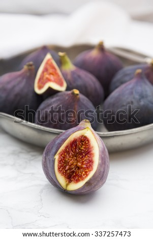 Figs in bowl, marble