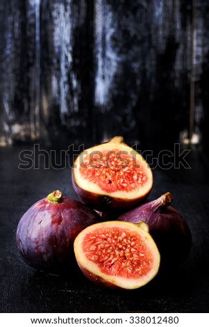 figs on a dark wooden background old retro vintage style selective soft focus