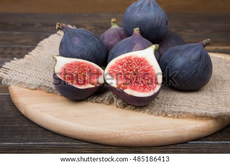 Figs on a wooden table and sackcloth background