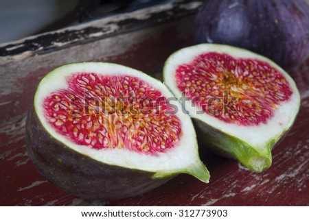 figs on wood background. selective focus on the center of the front figs slice