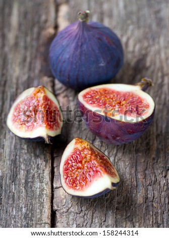 figs on wooden surface - stock photo