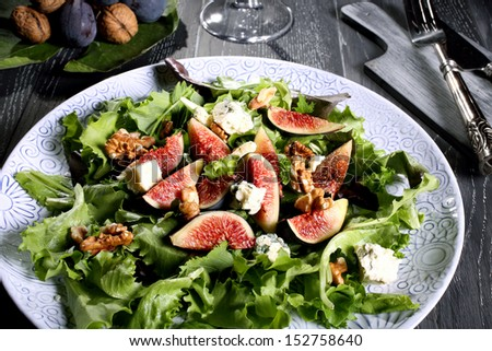 figs salad with  lettuce cheese and nut on ceramic plate gray background - stock photo