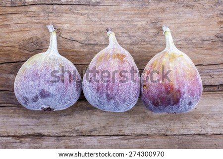 Figs whole shot on wood top view - stock photo