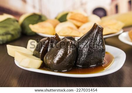 figs with honey traditional ecuadorian dessert on a plate higos con queso - stock photo