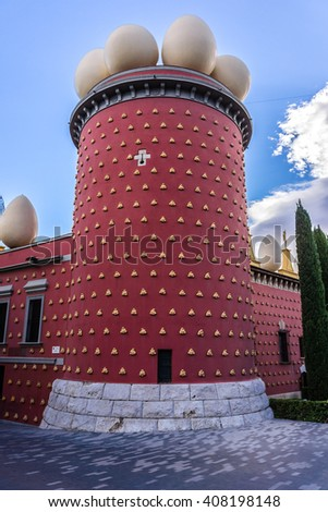 FIGUERAS, SPAIN - NOVEMBER 22, 2013: Giant eggs and imitation bread rolls line outside of Dali's Museum building in Figueras, Catalonia. Museum housing largest collection of works by Salvador Dali. - stock photo