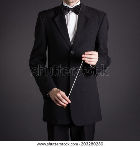 Figure conductor. - stock photo