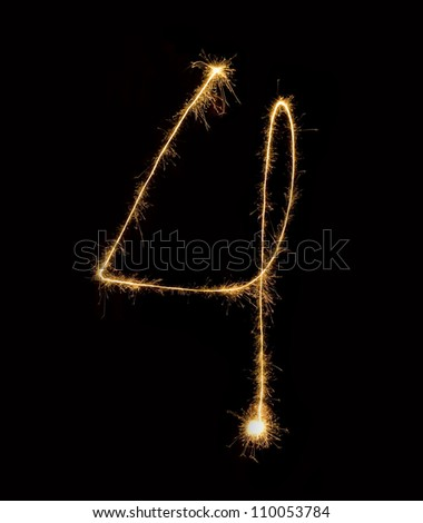 Figure four.abstract sparkler figures on black background. - stock photo