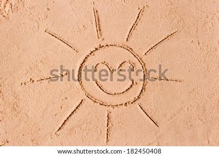 Figure joyous sun on the sand - stock photo