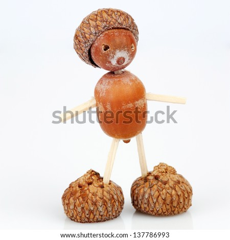 Figure made of acorns and matches