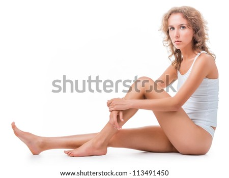 figure of a seated young woman in lingerie. Isolation on white background - stock photo