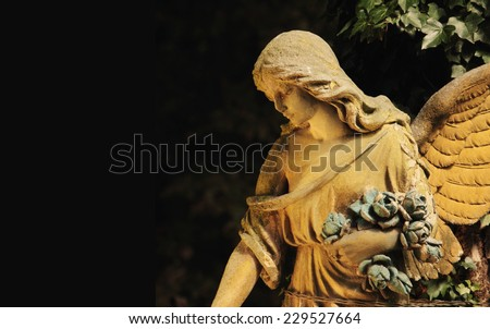 Figure of angel as a symbol of love, kindness, and suffering - stock photo
