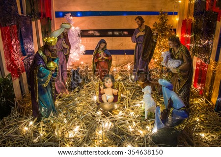 """Figure of even 'Birth of Jesus"""" in farm shed. - stock photo"""