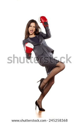Figure of happy business woman with boxing gloves in winning position