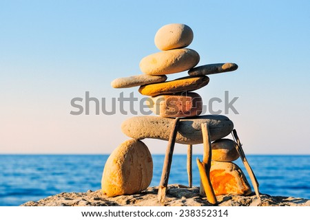 Figure of inukshuk on the seacoast   - stock photo