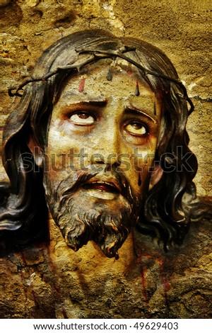 figure of Jesus Christ on vintage background - stock photo