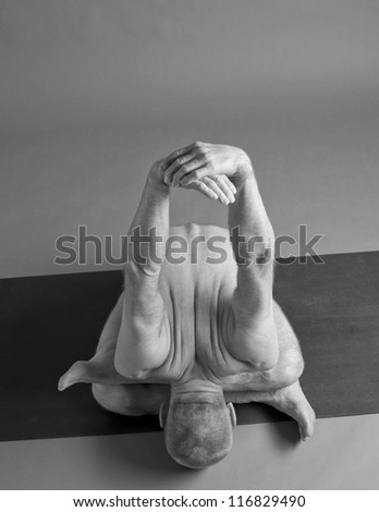 Figure of the young man on a grey background - stock photo