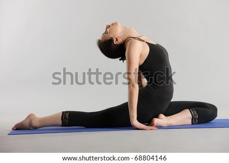 Figure of the young woman in sportswear on a grey background - stock photo
