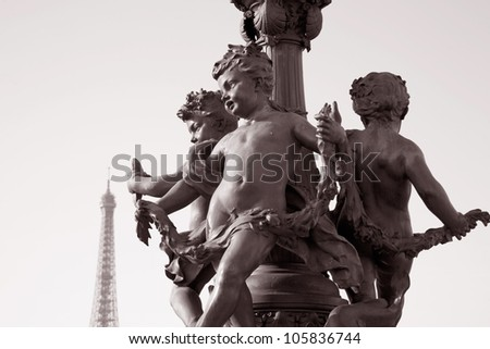 Figure on Pont Alexandre III Bridge with the Eiffel Tower in the Background in Sepia Black and White Tone in Paris, France - stock photo