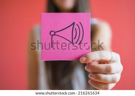 Figure speaker icon in the hand - stock photo