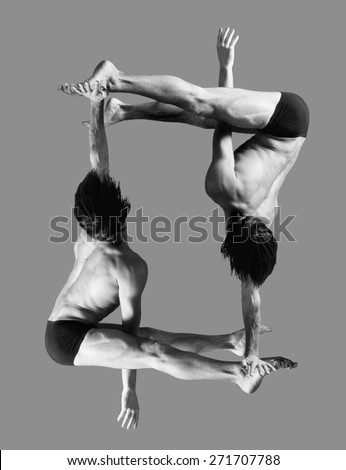 Figures gymnasts on a gray background.Athletes.Handstand.Black and white image - stock photo
