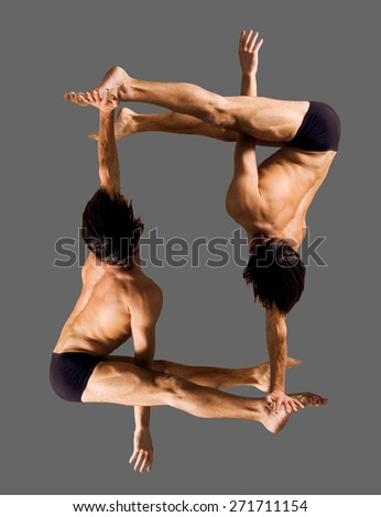 Figures gymnasts on a gray background.Athletes.Handstand.C?olor image   - stock photo