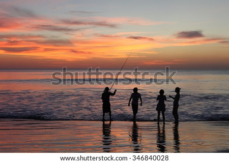 figures of fishermen at sunset, Bali