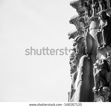 Figures of saints on portal of Chartres cathedral. Chartres, France. Aged photo. Black and white. - stock photo