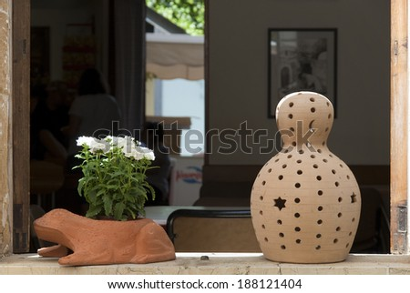 Figures on a window sill - stock photo